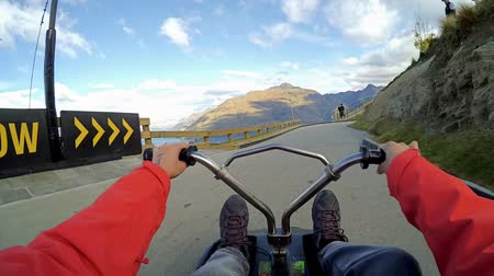 luge : Queenstown,New Zealand - 7,July 2017: A person playing the skyline luge car in Queenstown,New Zealand. Stock Footage