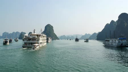 genuíno : Halong Bay,Vietnam - November 11,2017 : Beautiful scenic view of the cruises in Halong Bay. It is a beautiful natural wonder in northern Vietnam near the Chinese border.