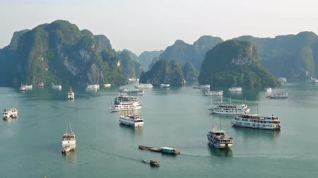 genuíno : Halong Bay,Vietnam - December 15, 2017 : Beautiful scenic view of the cruises in Halong Bay from Ti Top Island. It is a beautiful natural wonder in northern Vietnam near the Chinese border.
