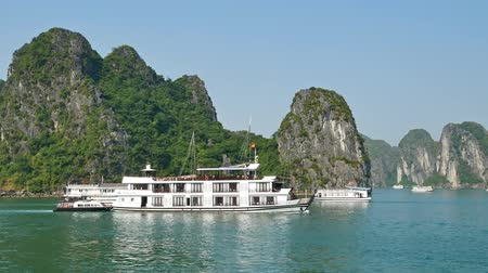 genuíno : Halong Bay,Vietnam - December 15,2017 : Beautiful scenic view of the cruises in Halong Bay. It is a beautiful natural wonder in northern Vietnam near the Chinese border.