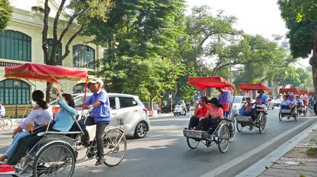 ha : Hanoi,Vietnam - May 24,2018 : Scenic view of busy traffic in Hanoi Old Quarter with trishaw, motorbikes and vehicles.