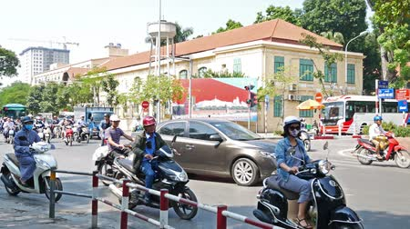 ha : Hanoi,Vietnam - May 25,2018 : View of busy traffic in an intersection with many motorbikes and vehicles in Hanoi, capital of Vietnam. Stock Footage