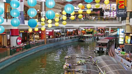 mines : Kuala Lumpur,Malaysia - September 11,2018 : The Mines Cruise is a boat ride on two large lakes next to The Mines shopping mall in Seri Kembangan,people can seen exploring around it.