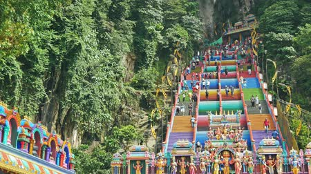 batu caves : Kuala Lumpur,Malaysia - December 15 , 2018: Scenic view of the Batu Caves in Gombak, Malaysia. People can seen climbing the stairs to or from the temple that is located inside the cave.