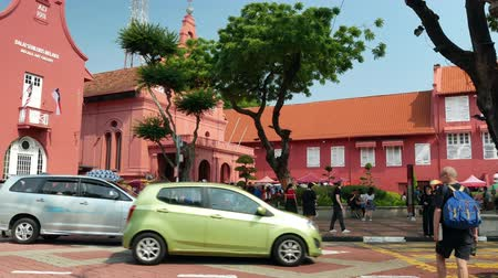 rickshaw : Malacca,Malaysia - May 3,2019: Scenic view of the Christ Church Malacca and Dutch Square,people can seen exploring around it. It has been listed as UNESCO World Heritage Site since 772008. Stock Footage