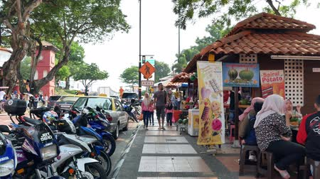 コロニアル : Malacca,Malaysia - May 18,2019: Food stalls scenic view near the Christ Church Malacca and Dutch Square,people can seen having their food around it. 動画素材