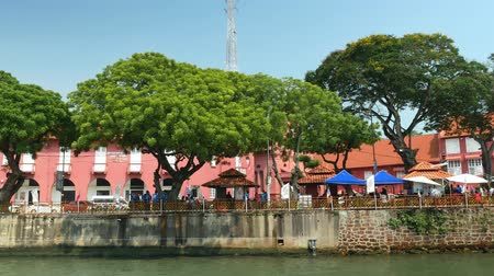 risciò : Malacca,Malaysia - May 18,2019: Scenic view of the Christ Church Malacca and Dutch Square,people can seen exploring around it. It has been listed as UNESCO World Heritage Site since 772008.