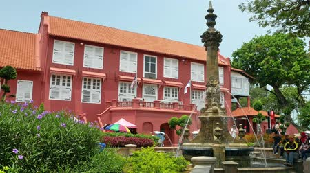 colonial : Malacca,Malaysia - May 18,2019: Scenic view of the Christ Church Malacca and Dutch Square,people can seen exploring around it. It has been listed as UNESCO World Heritage Site since 772008.