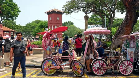 rickshaw : Malacca,Malaysia - May 18,2019: Scenic view of the Christ Church Malacca and Dutch Square,people can seen exploring around it. It has been listed as UNESCO World Heritage Site since 772008.