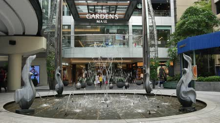 kl : Kuala Lumpur,Malaysia - May 18,2019 :  Scenic view of the water feature in front of the The Gardens Mall shopping mall. People can seen exploring around it. Stock Footage