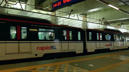 kl : Kuala Lumpur, Malaysia - June 2,2019 : KL LRT Star train public transport passing through Plaza Rakyat station. People taking LRT as transportation to work and shopping.