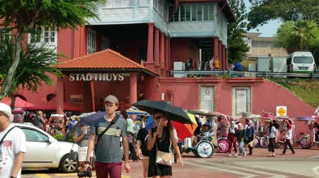 holandês : Malacca,Malaysia - June 2,2019: Scenic view of the Christ Church Malacca and Dutch Square,people can seen exploring around it. It has been listed as UNESCO World Heritage Site since 772008. Stock Footage