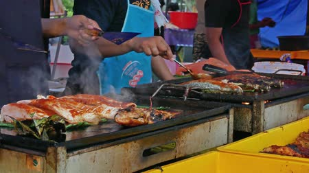 separè : Kuala Lumpur,Malaysia - June 2,2019: Tasty grilled fish cooking by the hawker in Ramadan Bazaar during the holy month of Ramadan.