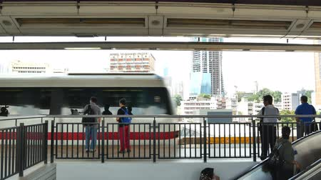 rapid transit : Kuala Lumpur, Malaysia - June 2,2019 : KL LRT train public transport passing through Pasar Seni station. People taking LRT as transportation to work and shopping. Stock Footage
