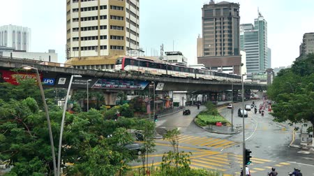 kl : Kuala Lumpur, Malaysia - August 12,2019 : KL LRT Star train public transport passing through Plaza Rakyat station. People taking LRT as transportation to work and shopping. Stock Footage