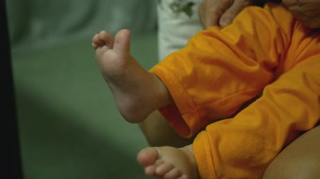 Close-up of the baby exercising his tiny feet. Stock mozgókép
