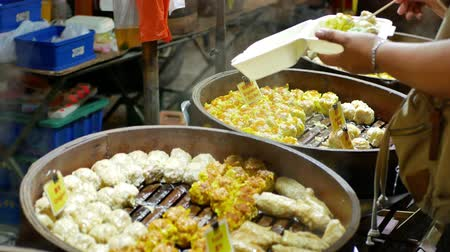 bamboo steamer : People can seen buying dim sum at the night market. Stock Footage