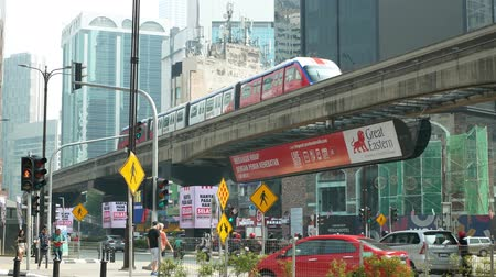 bintang : Kuala Lumpur, Malaysia - September 7,2019 : KL Monorail train public transport passing through Bukit Bintang area. People can seen exploring around it.