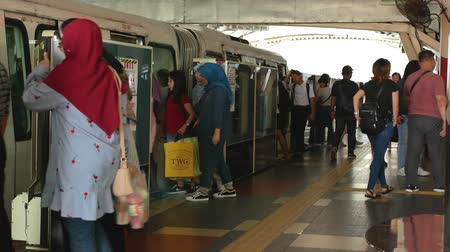 highspeed : Kuala Lumpur, Malaysia - September 9,2019 : KL Monorail train arriving to the station and crowd of people getting in and out of the train. Stock Footage