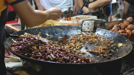 vegetable wok : Street food vendor frying carrot cake at the night market.