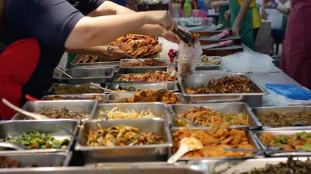 food court : There are various types of dishes selling at the food stall, people can seen buying the dishes at the stall.