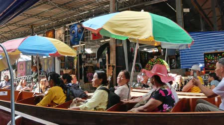 market vendor : Ratchaburi,Thailand - November 5,2019 : Damnoen Saduak floating market is the most popular in Thailand, located 100 km from downtown Bangkok. People can seen exploring around by the boats.
