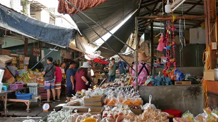 samut : Maeklong,Thailand - Nov 7 ,2019 : Tourists can seen exploring and shopping along the Maeklong Railway Market.It is a Thai market selling fresh vegetables,food, fruit,as well as souvenirs and clothing.
