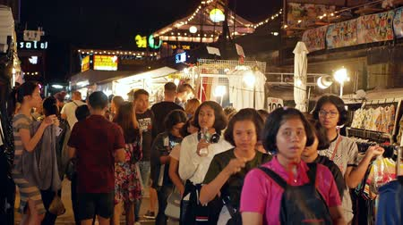 получать : Bangkok,Thailand - Nov 18,2019 :People can seen exploring and shopping around Ratchada Rot Fai Train Night Market.The night markets are a great way to get a slice of local life and eat authentic foods Стоковые видеозаписи
