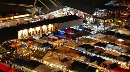 Bangkok,Thailand - Nov 18,2019 : Aerial view of the Ratchada Rot Fai Train Night Market.People can seen exploring and shopping around it.