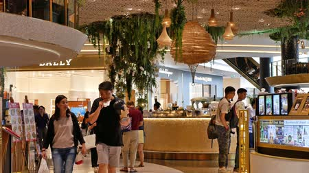 Iconsiam ,Thailand -Dec 4 ,2019:  Ground floor floating market in Iconsiam shopping mall can get the traditional Thai snacks, shops for regional handicrafts and etc.People can seen exploring around it
