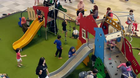 Kuala Lumpur,Malaysia - December 10,2019 : Children can seen playing the playground with their parent at MyTOWN shopping centre.