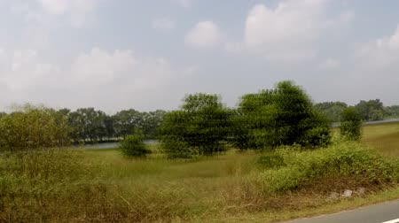 okno : The view from the car window at the scenery in Thailand