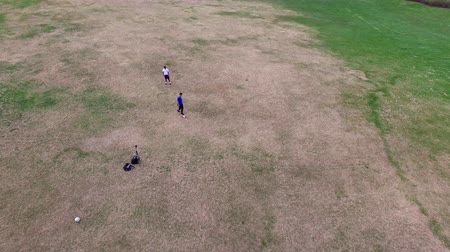 sportowiec : 2 Soccer Players Practicing - Park Aerial Fly Over Wideo