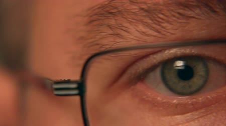 gözler : IT Professional Eye Closeup with Glasses Tracking Shot