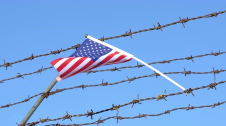 farpado : American flag waving on barbed wire fence 4K Stock Footage