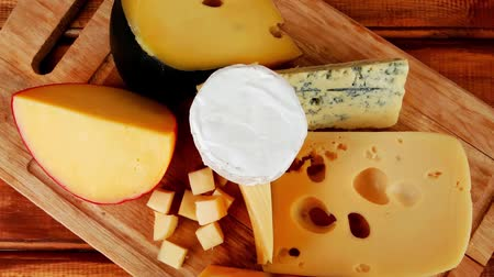 fresh cheeses : dairy food cheeses on wooden plate over table