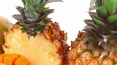 ananas : exotic diet food - set of lot of tropical fruits include pineapple and mango isolated over white background Stok Video