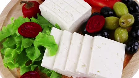 rokfor : feta cheese with olives on wooden plate