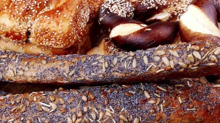 хлеб : mix of fresh homemade baguettes   pretzels and wheat loafs  on wooden table