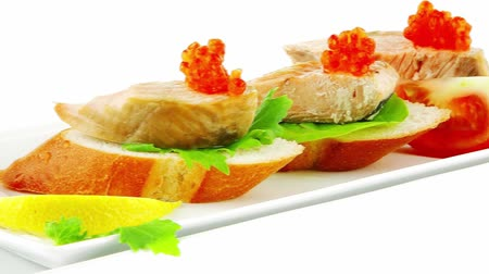 sekaná : salmon chunks and caviar on baguette with olives