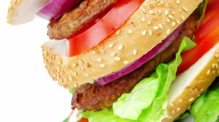 sandviç : big double grilled hamburger on ceramic plate isolated  over white background Stok Video