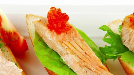 sekaná : fried salmon on baguettes isolated over white