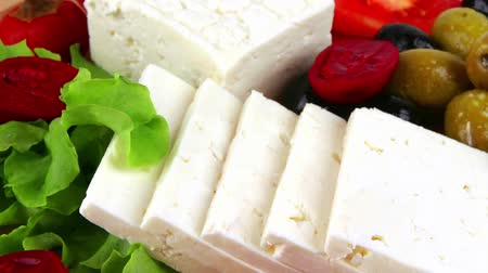 italian food : white cheese served on plate with vegetables