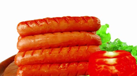 finest : grilled beef red sausages on wooden plate Stock Footage