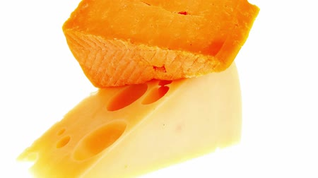 soft cheeses : two french gourmet yellow cheeses  isolated over white background Stock Footage
