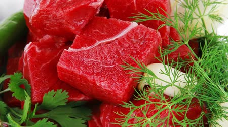 cielęcina : slices of raw fresh beef meat fillet in a white bowls with dill and green peppers isolated over white background
