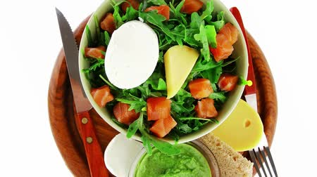 fresh cheeses : fresh green salad with smoked salmon in green bowl