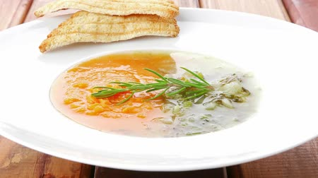 zupa : european cuisine: dual components vegetable soup with toasts over wood
