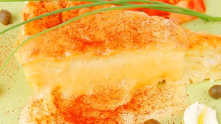massa : food : cheese casserole piece over green plate served with chives and tomatoes isolated over white