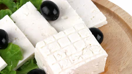 cheese piece : feta cheese with olives on wooden plate
